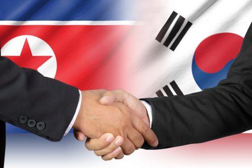 Shaking hands of South Korea and North Korea
